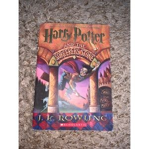 Harry Potter & the sorcerers stone soft cover book